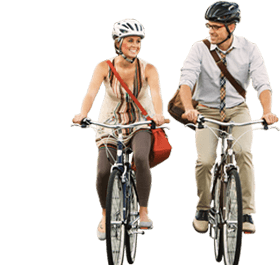 Happy couple rides bikes rented from Bike and go